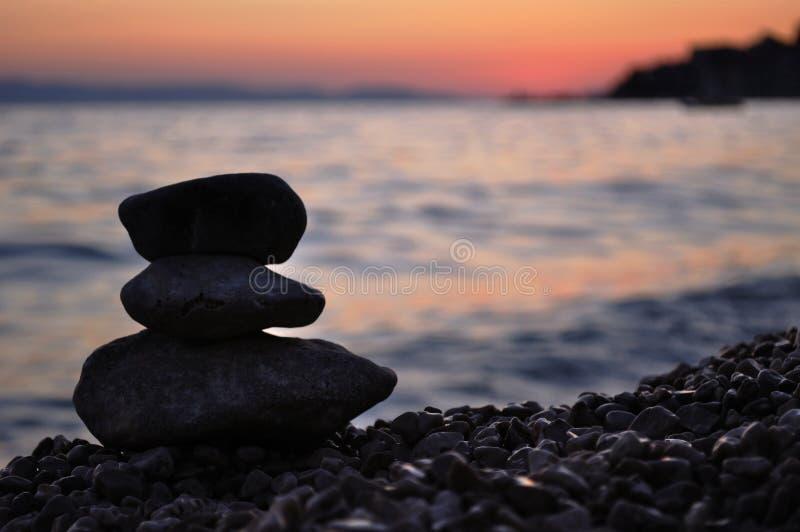 Silhouette of three zen rocks on the beach. Silhouette of three rocks on the beach at sunset. Podgora, Croatia royalty free stock image