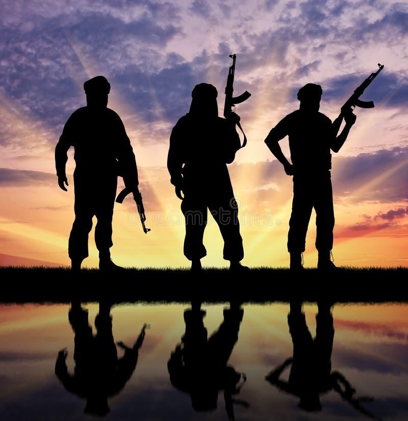 Silhouette of three terrorists stock image