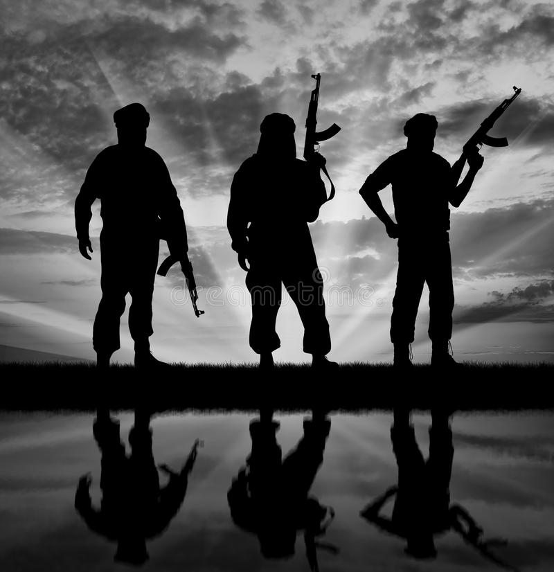 Silhouette of three terrorists stock photography