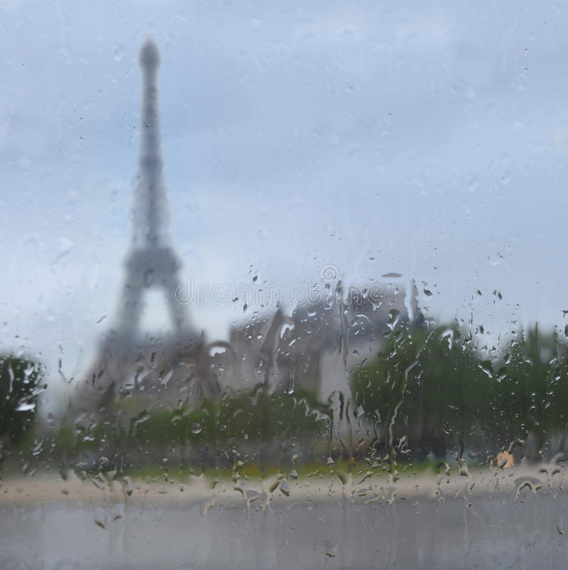 Silhouette of Tour Eiffel through the window with rain drops stock photo