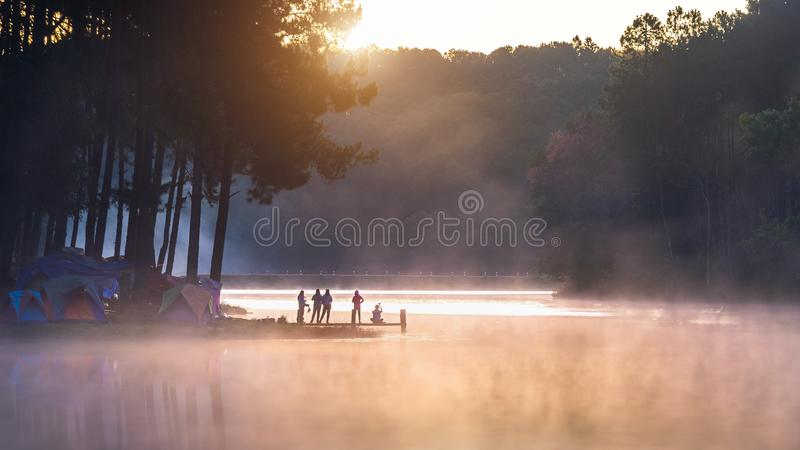 Silhouette of tourist enjoying at Pang Ung in morning, Mae Hong Son in Thailand. royalty free stock photos