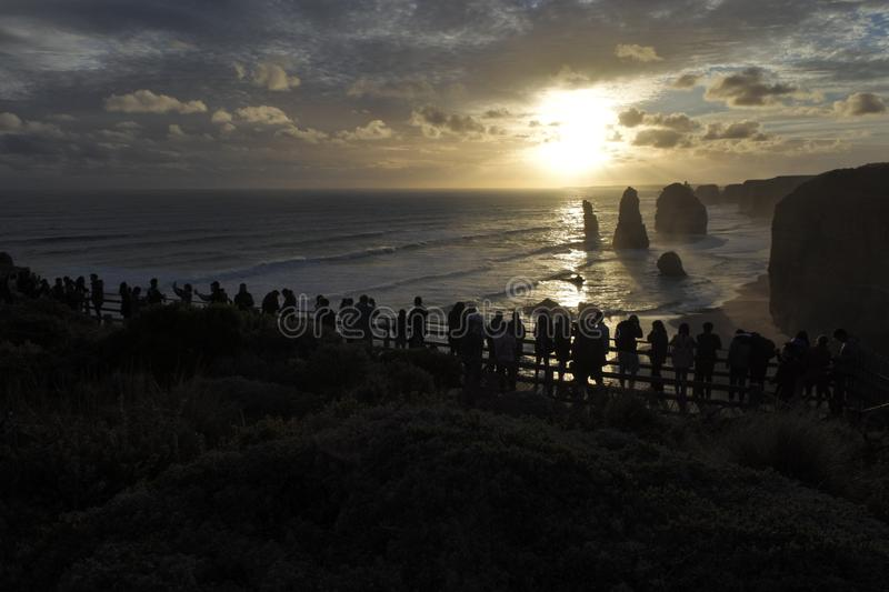 Silhouette of Tourists looking at the Twelve Apostles Great Ocean Road in Victoria Australia royalty free stock photo
