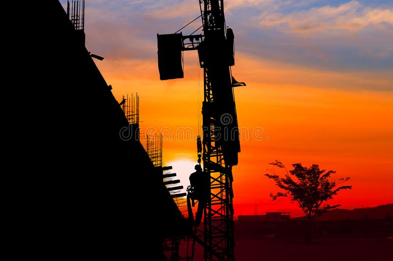 Silhouette Tower crane construction work on sunset-sunrise time background and copy space add text stock photos