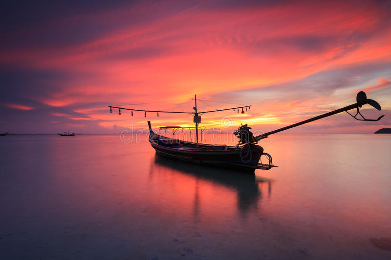 Silhouette traditional longtail boat and beautiful red sky and s royalty free stock images