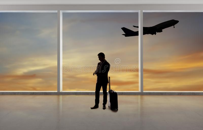 Silhouette of Businessman Traveling at an Airport royalty free stock photography