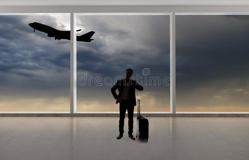 Silhouette of Businessman Traveling at an Airport stock photography