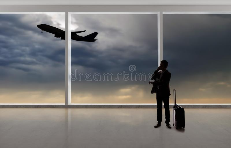 Silhouette of Businessman Traveling at an Airport stock images