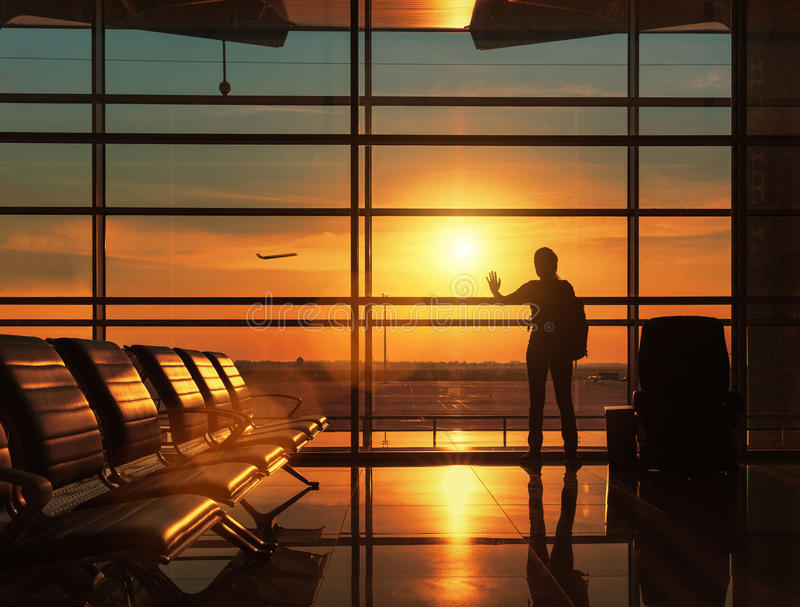 Silhouette of traveling woman stock photography