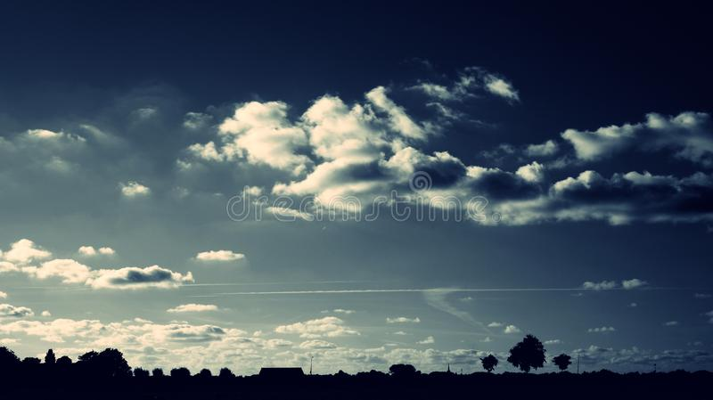 Silhouette of Trees Under Cloudy Sky royalty free stock photo
