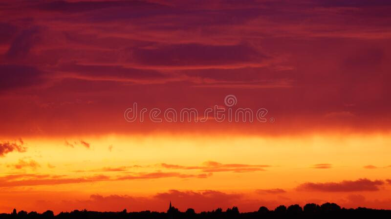Silhouette of Trees Under Orange and Red Sky stock photos