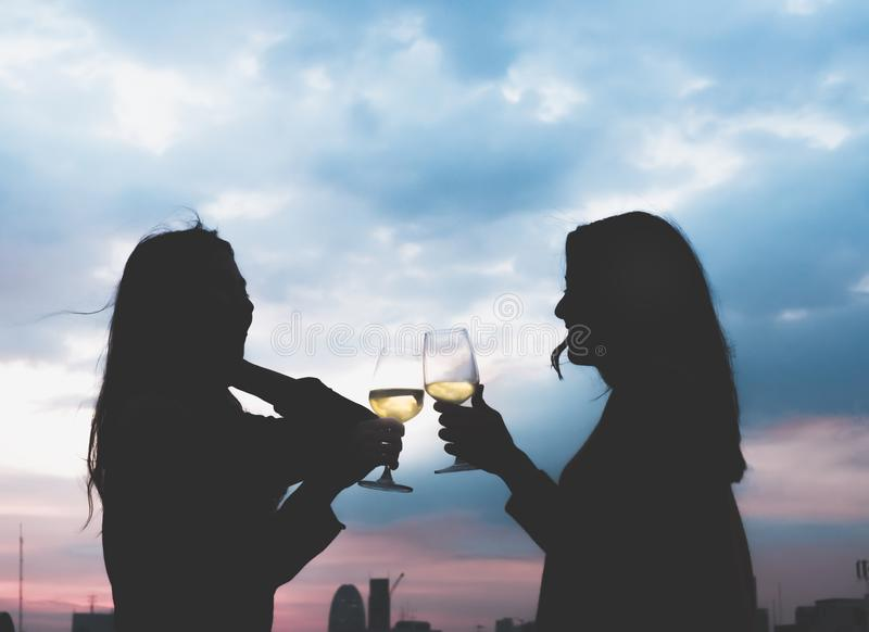 Silhouette two asia lesbian lgbt couple toast champagne glass at royalty free stock images