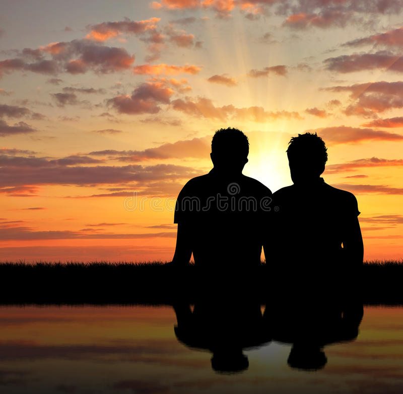Silhouette of two gay stock photography
