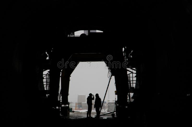 The silhouette of two people in a high-speed railway tunnel under construction stock photography