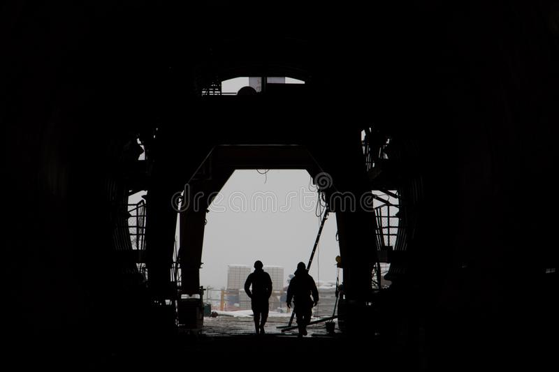 The silhouette of two people in a high-speed railway tunnel under construction royalty free stock photos
