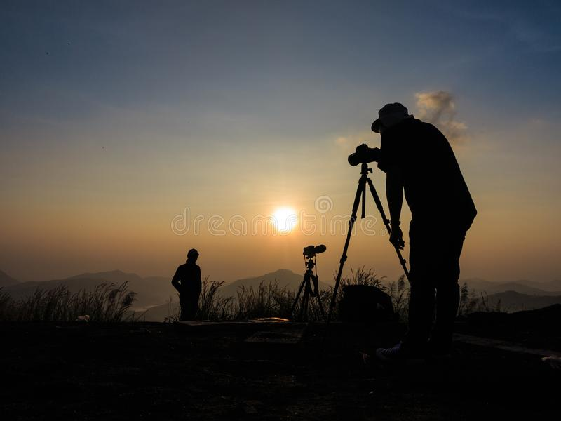 Silhouette of two photographer who like to travel and taking pic royalty free stock photography