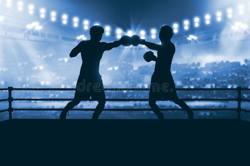 Silhouette of two professional asian boxer fight in the boxing m royalty free stock image