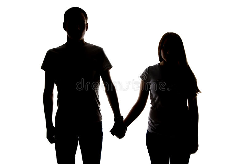 Silhouette Of Two Teenagers Holding Hands Stock Image ...