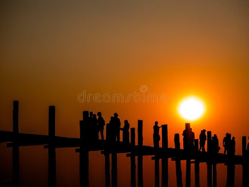 The silhouette of U-bein bridge in Mandalay. The silhouette peple on U-bein bridge in Mandalay royalty free stock photography