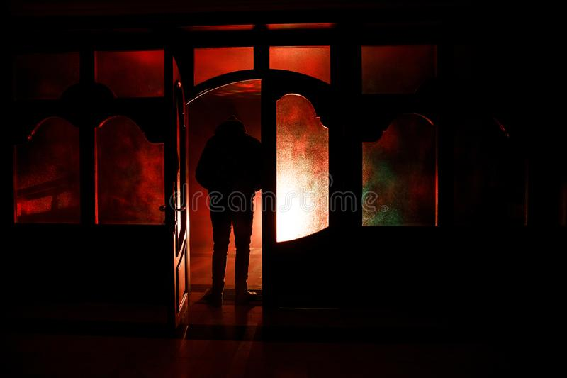 Download Silhouette Of An Unknown Shadow Figure On A Door Through A Closed Glass Door. & Silhouette Of An Unknown Shadow Figure On A Door Through A Closed ...