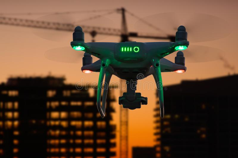Silhouette of Unmanned Aircraft System UAV Quadcopter Drone stock image