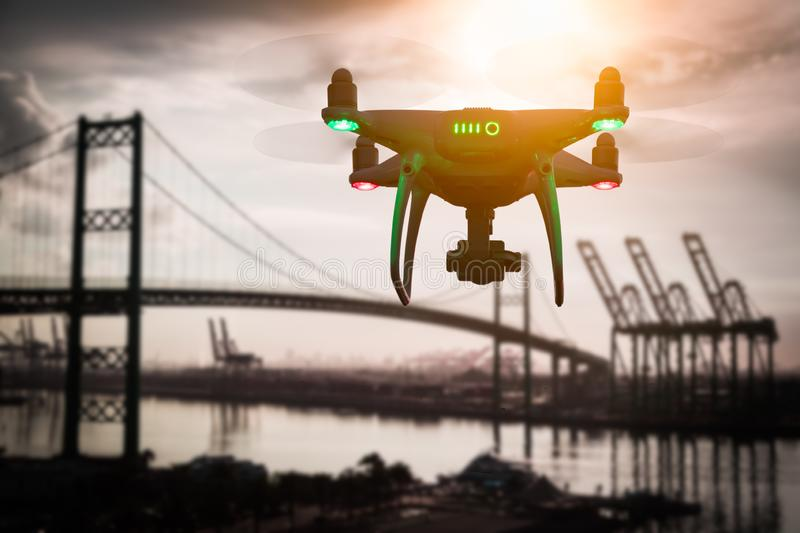 Silhouette of Unmanned Aircraft System UAV Quadcopter Drone royalty free stock image