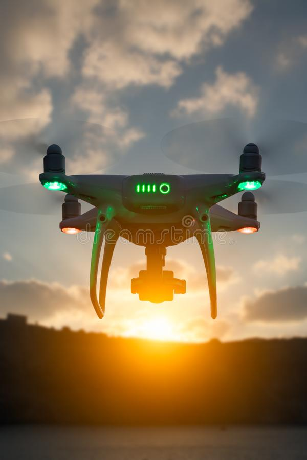 Silhouette of Unmanned Aircraft System UAV Quadcopter Drone royalty free stock photography