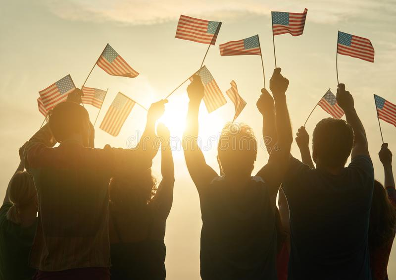 Silhouette of usa family against sunshine background. Group of patriotic people, back rear view stock photography