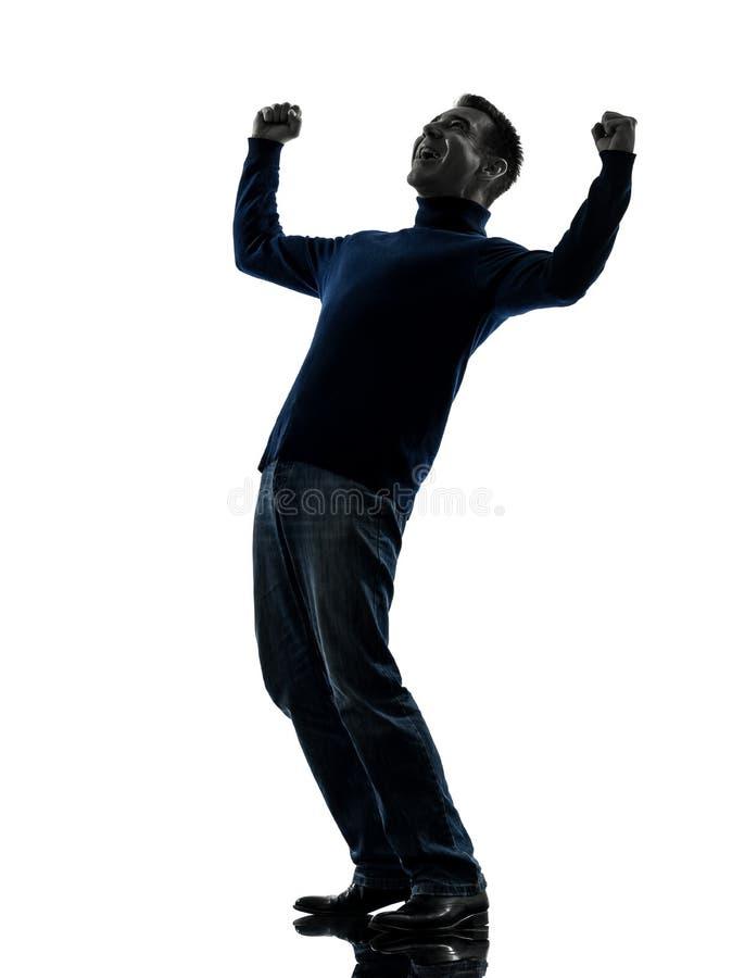 Silhouette victorieuse de stong heureux d'homme intégrale images libres de droits