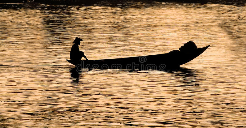 Silhouette of Vietnamese fisherman stock photography