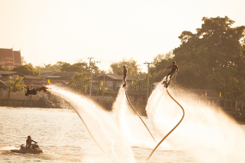 Silhouette and vintage color styl of showing flyboard on Chaophya stock images