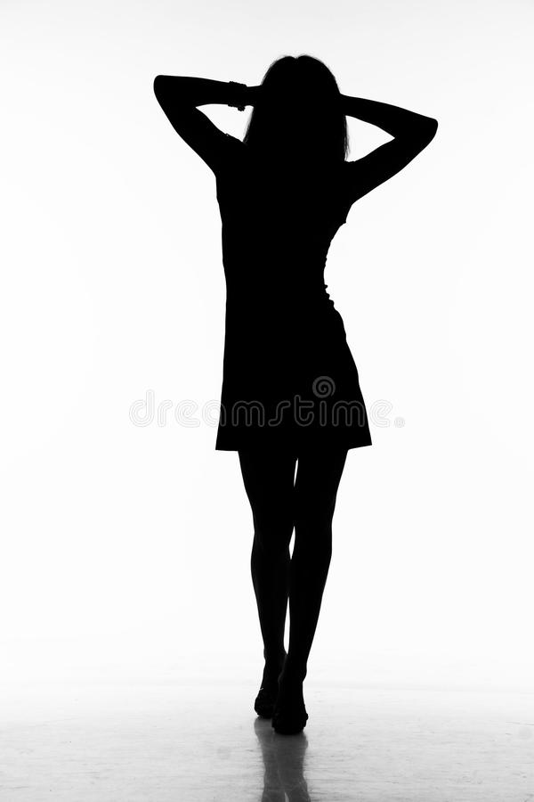 Silhouette of walking woman royalty free stock photography