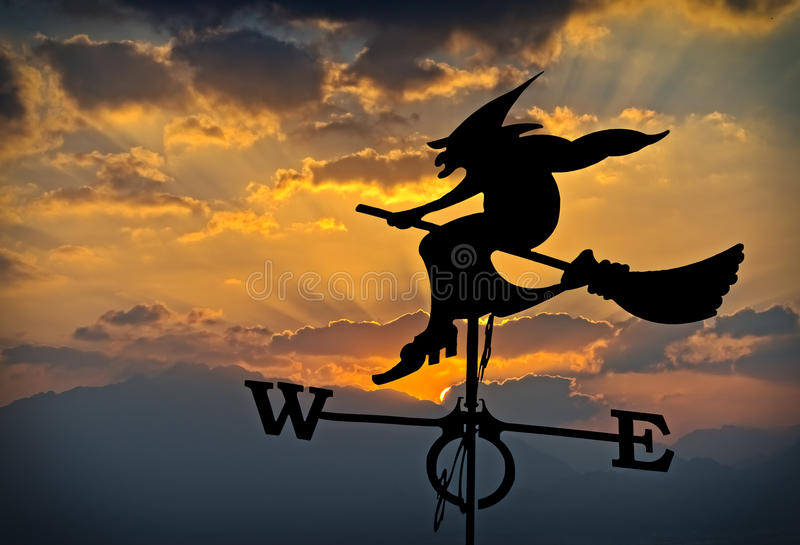 Silhouette of weather vane with cloudscape as background stock photos