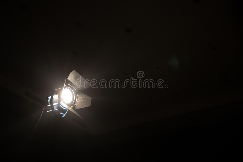 Silhouette Wheelchair back the scene white and blur spotlight at theater for movie film and video . stock photo