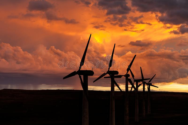 Silhouette of wind turbines on the background of the storm sky royalty free stock image