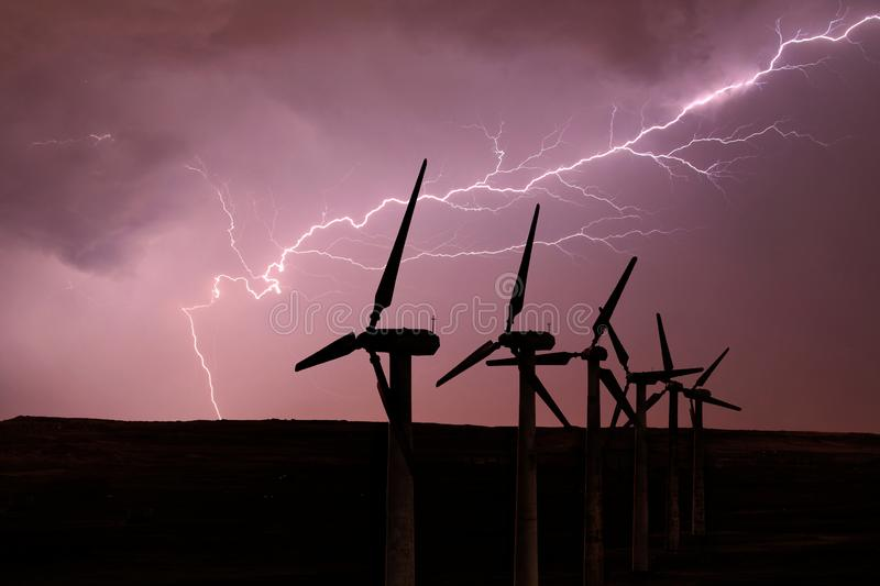 Silhouette of wind turbines on the background of a stormy sky royalty free stock image