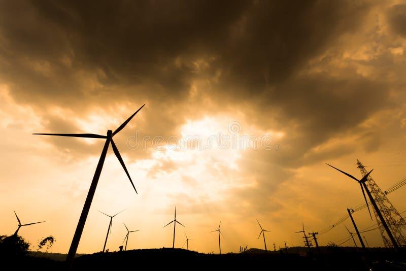 Silhouette wind turbines stock image