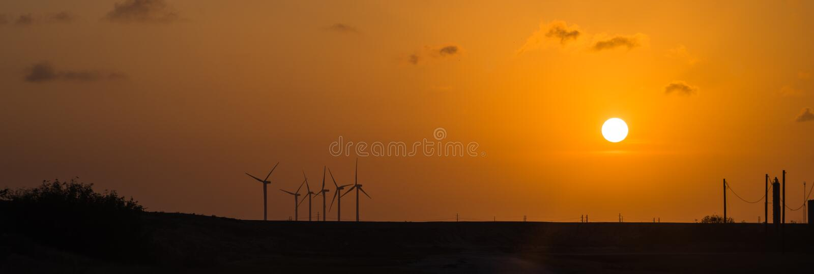 Wind turbines at orange sunset in the rural of Corpus Christi, Texas, USA stock photos
