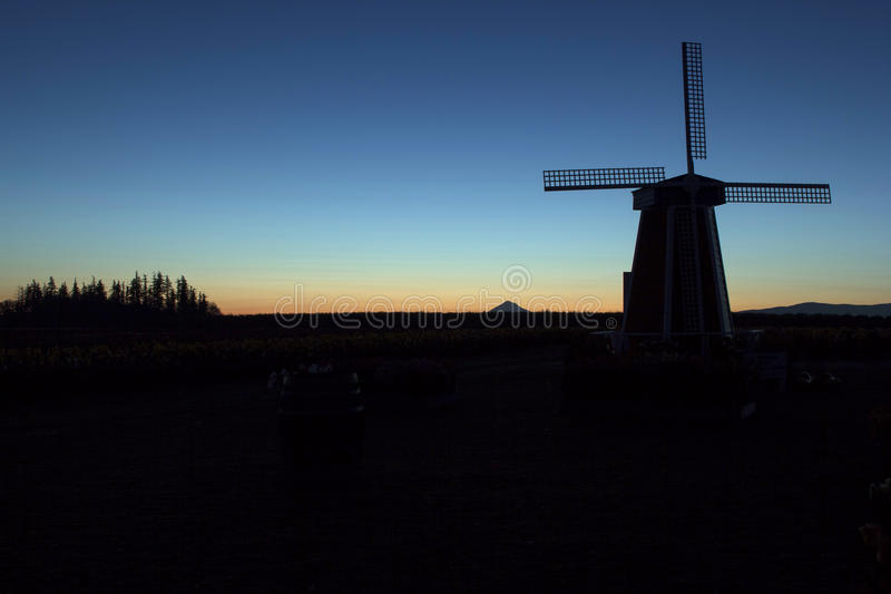 Silhouette of Windmill at Sunrise royalty free stock photography