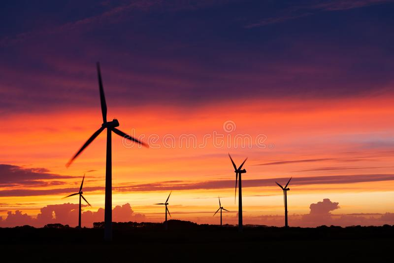 Silhouette of windturbines on an amazing sunset. Silhouette of wind turbines over an amazing sunset sky stock photography