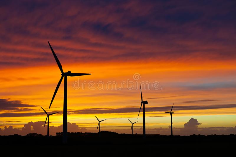 Silhouette of windturbines on an amazing sunset. Silhouette of wind turbines over an amazing sunset sky royalty free stock image