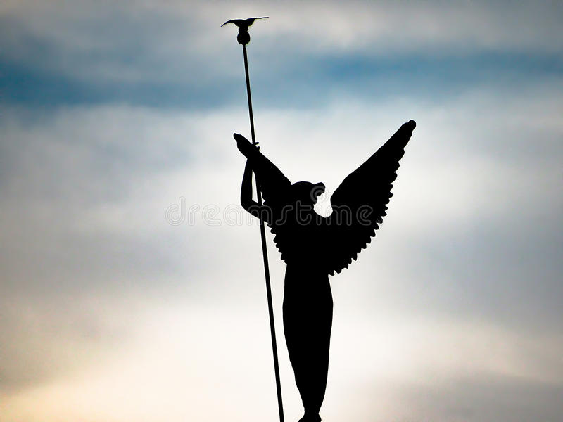 Silhouette of a Winged Woman stock photo