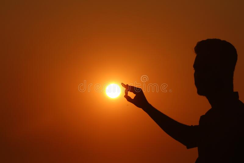 Silhouette of Woman Against Sunset royalty free stock image