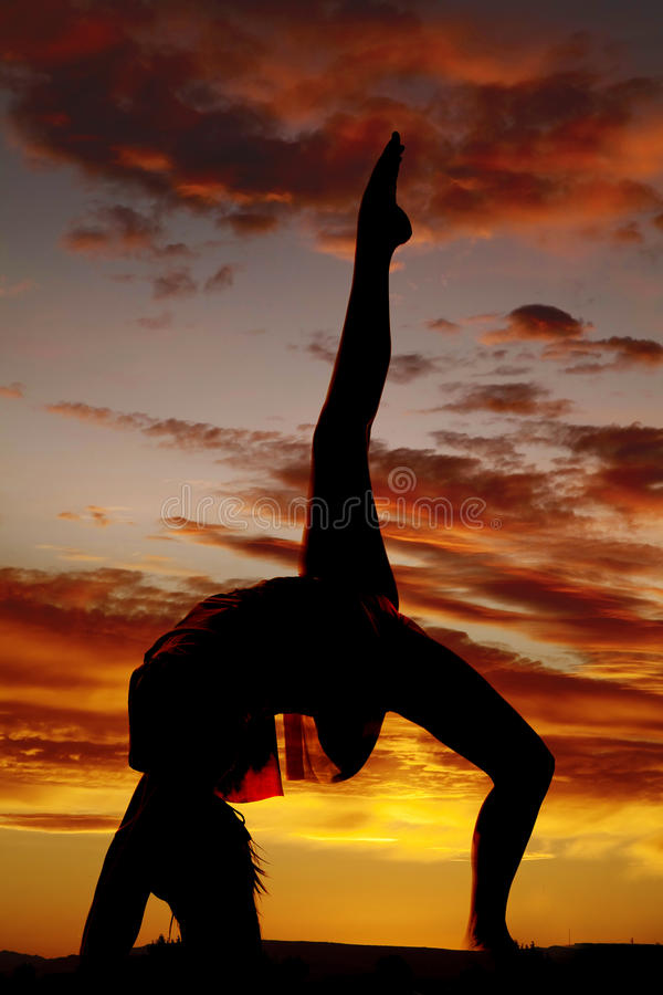 Silhouette woman backbend leg up stock images
