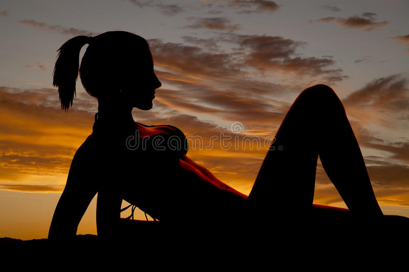 Silhouette Of A Woman In A Bikini On Elbows Let Up Stock Photography