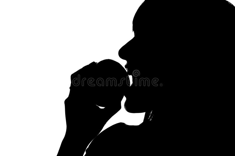Download Silhouette Of Woman Biting Into Apple Stock Image - Image: 32516977