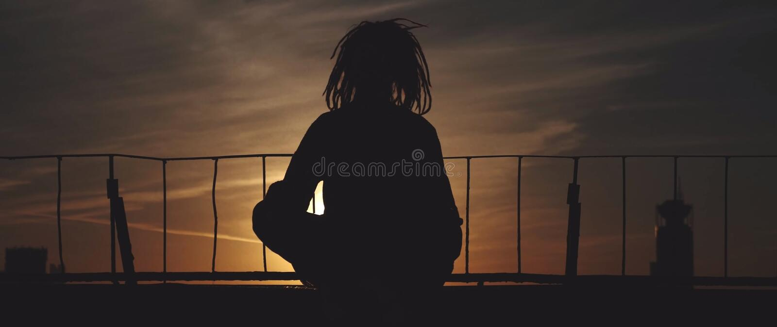 Silhouette of woman on the bridge stock images