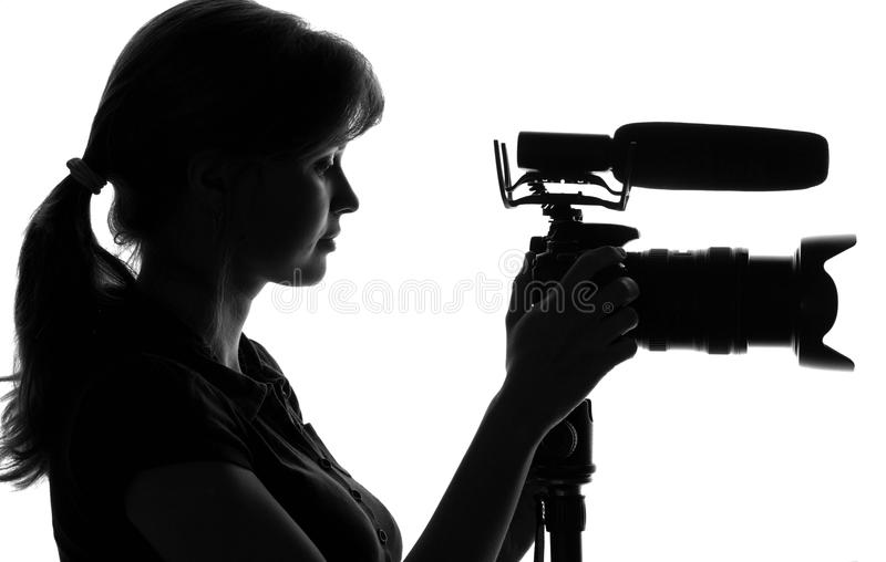 Silhouette of a woman with a camera stock images