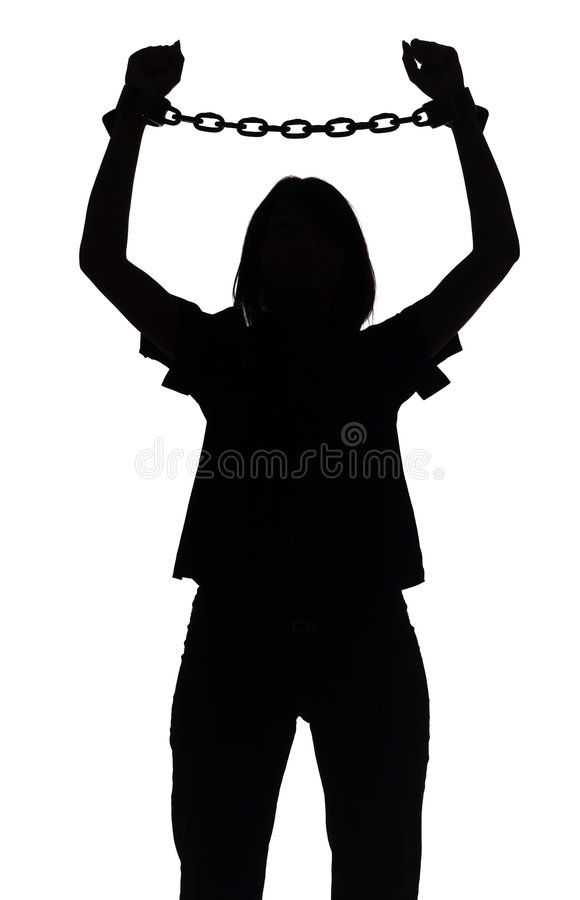 Silhouette of woman with chains stock photos