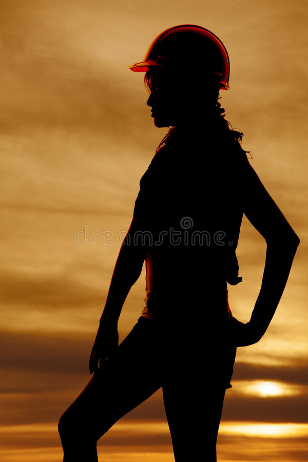 Silhouette of woman construction hand hip sunset stock images