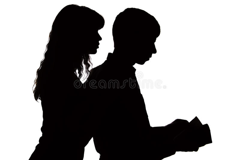 The silhouette of a woman controlling the salary of a family and peering into the wallet. The silhouette of a young women controlling the salary of a family and stock photo